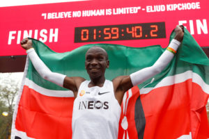 Kenya's Eliud Kipchoge, the marathon world record holder, celebrates after a successful attempt to run a marathon in under two hours in Vienna, Austria, on October 12, 2019. Photo by Leonhard Foeger/Reuterrs