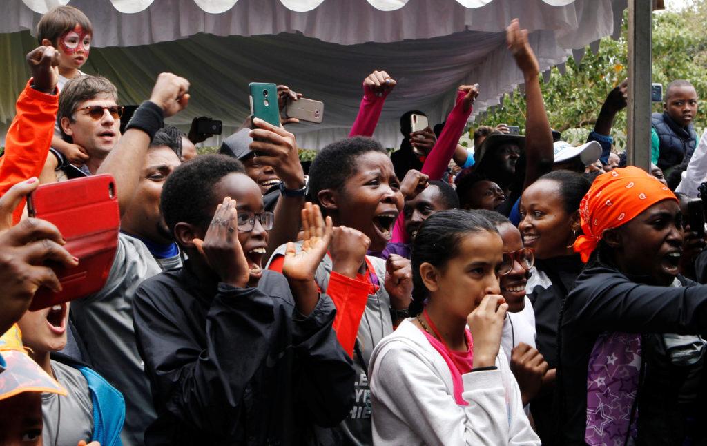 In Nairobi, Kenya, celebrations as Eliud Kipchoge, the marathon world record holder, runs a marathon in under two hours in Vienna, Austria, on October 12, 2019. Photo by Njeri Mwangi/Reuters