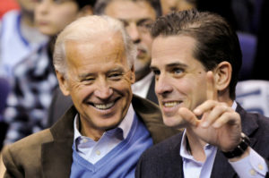 FILE PHOTO: U.S. Vice President Joe Biden and his son Hunter Biden attend an NCAA basketball game between Georgetown University and Duke University in Washington, U.S., January 30, 2010. Photo by Jonathan Ernst/Reuters