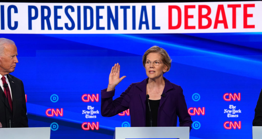 Democratic presidential candidate former Vice President Joe Biden looks on as Senator Elizabeth Warren speaks during the fourth U.S. Democratic presidential candidates 2020 election debate at Otterbein University in Westerville, Ohio U.S., October 15, 2019. REUTERS/Shannon Stapleton - HP1EFAG01IY7Q