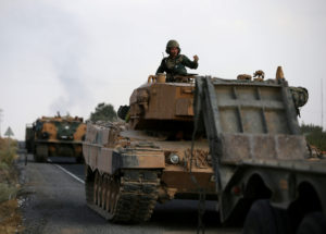 Turkish army vehicles on October 18, 2019, are moving on a road near the Turkish border town of Ceylanpinar, Sanliurfa province, Turkey. File photo by Stoyan Nenov/Reuters