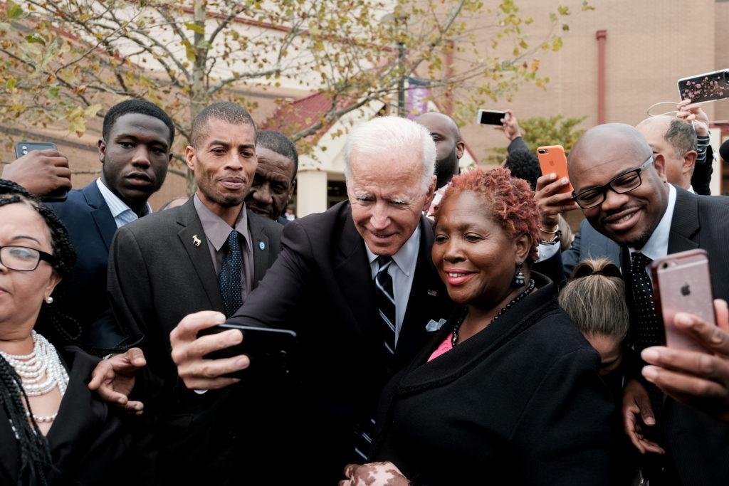 Former U.S. Vice President Joe Biden pauses to take a selfie as he …