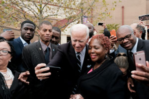 Former U.S. Vice President Joe Biden pauses to take a selfie as he departs funeral services for late U.S. Representative Elijah Cummings (D-MD) at the New Psalmist Baptist Church in Baltimore, Maryland, U.S., October 25, 2019. Photo by Michael A. McCoy/Reuters.