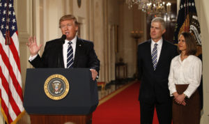 U.S. President Donald Trump announces his nomination of Neil Gorsuch to be an associate justice of the U.S. Supreme Court as Gorsuch (R) stands with his wife Marie Louise at the White House in Washington, D.C., U.S., January 31, 2017. REUTERS/Kevin Lamarque - HT1ED21047D12