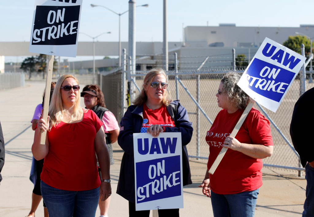 General Motors assembly workers (L-R) Teresa Oakes, Connie Ben and Shelly Cooper picket outside the shuttered Lordstown Assembly plant during the United Auto Workers (UAW) national strike in Lordstown, Ohio, U.S. September 20, 2019. REUTERS/Rebecca Cook - RC1412EBA940