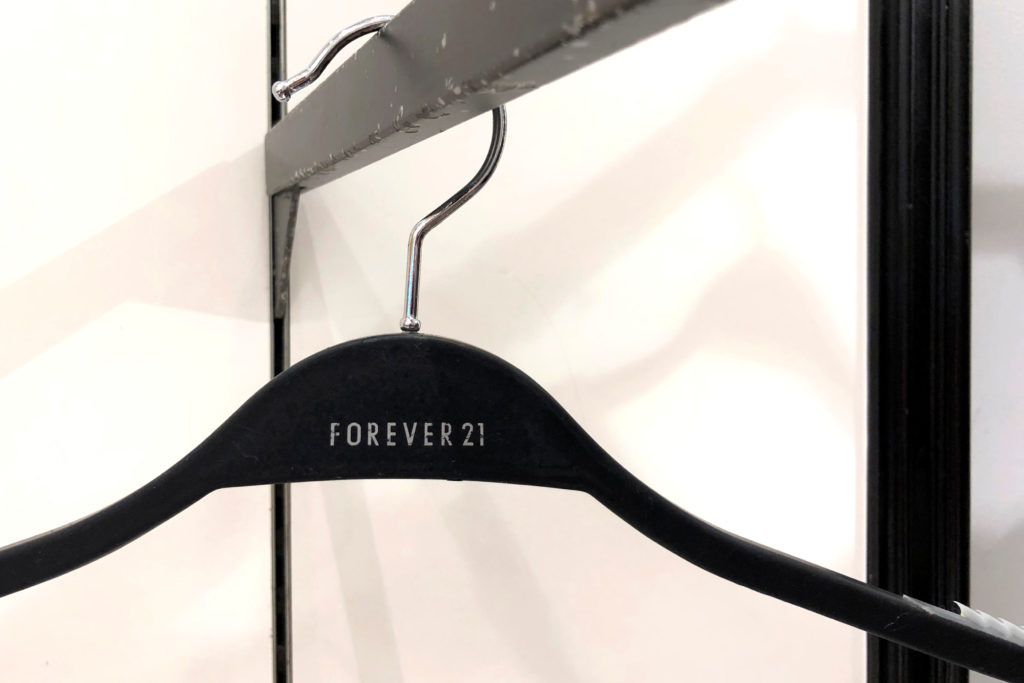 An empty clothes hanger hangs from a rack at a Forever 21 fashion retail store at the King of Prussia mall in Pennsylvania on September 30, 2019. Photo by Mark Makela/Reuters