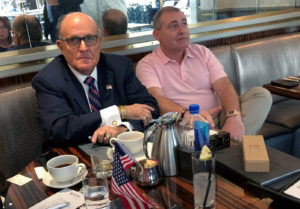 U.S. President Donald Trump's personal lawyer Rudy Giuliani has coffee with Ukrainian-American businessman Lev Parnas at the Trump International Hotel in Washington, U.S. September 20, 2019. Photo by REUTERS/Aram Roston/File Photo