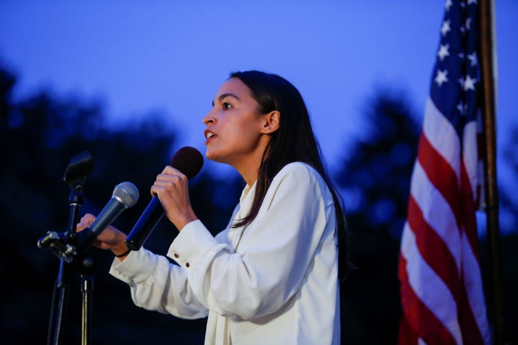 Representative Alexandria Ocasio-Cortez speaks to people as they gather for a vigil to remember victims of the mass shootings at Dayton and El Paso, at Grand Army Plaza in Brooklyn, New York, U.S., August 5, 2019. REUTERS/Eduardo Munoz