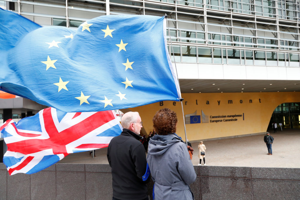 Anti-Brexit protesters hold British and European Union flags outside the EU Commission headquarters in Brussels, Belgium October 11, 2019. Photo by REUTERS/Francois Lenoir