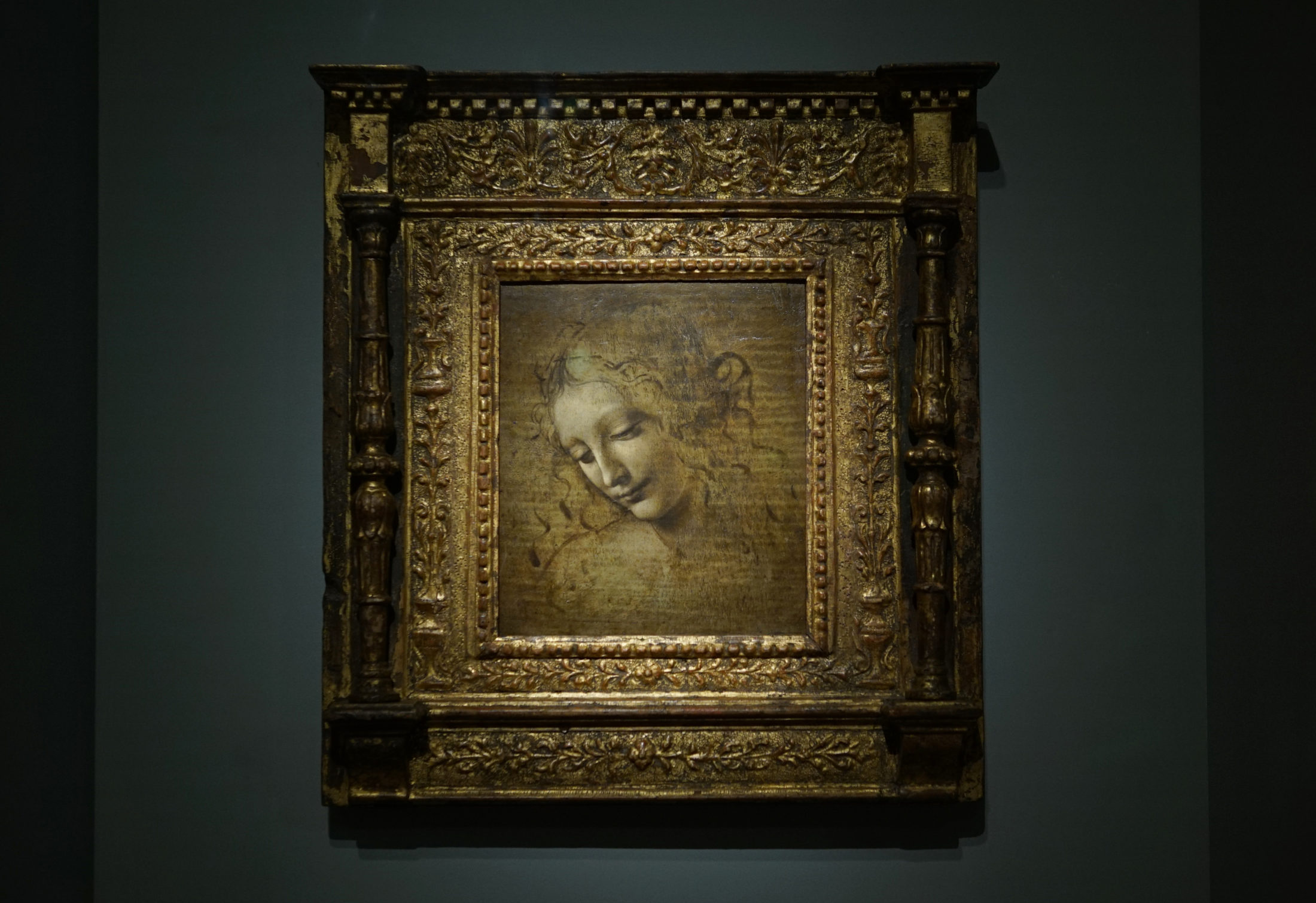 "Da Vinci's ""Head of a Woman (La Scapigliata),"" partly noteworthy for its unfinished state."