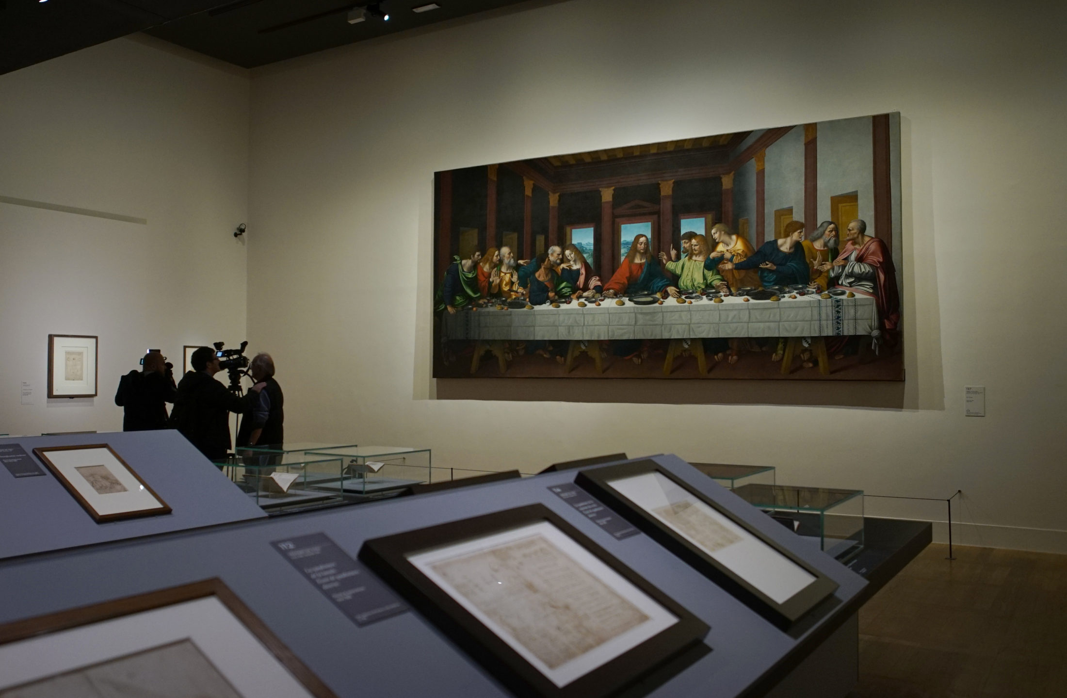 "A copy of ""The Last Supper"" the hangs above rows of da Vinci's drawings and manuscripts. Photo by Joshua Barajas/PBS NewsHour"