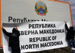 "Workers set up a sign with the new name at the border between Macedonia and Greece, near Gevgelija, on February 13, 2019. The sign reads: ""Republic of North Macedonia."" Photo by Ognen Teofilovski/Reuters"