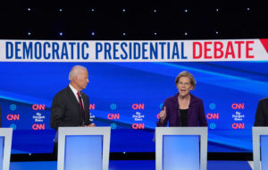 Democratic presidential candidate and former Vice President Joe Biden listens to Senator Elizabeth Warren during the fourth U.S. Democratic presidential candidates 2020 election debate in Westerville, Ohio.REUTERS/Shannon Stapleton