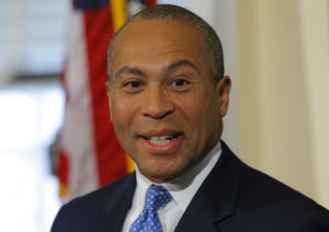 "FILE PHOTO: Massachusetts Governor Deval Patrick introduces William ""Mo"" Cowan as his choice to serve as the interim U.S. Senator until a special election is held to elect the successor to Former Senator John F. Kerry (D-MA) at the State House in Boston, Massachusetts January 30, 2013. Photo by Brian Snyder/Reuters"