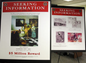 FBI posters displaying works by artists Johannes Vermeer and Edgar Degas are seen during a 2013 press conference held to appeal to the public for help in returning artwork stolen in 1990 from the Isabella Stewart Gardner Museum. Photo by Jessica Rinaldi/Reuters