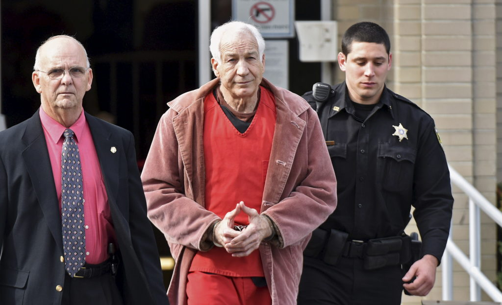 FILE: Convicted child molester Jerry Sandusky (C), a former assistant football coach at Penn State University, leaves after his appeal hearing at the Centre County Courthouse in Bellefonte, Pennsylvania, U.S. on October 29, 2015. Photo by REUTERS/Pat Little/File Photo