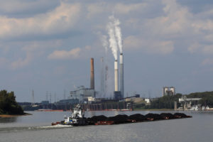 A towboat pushes barges towards the Mill Creek Station power plant on the Ohio River in Louisville, Kentucky, U.S., September 15, 2017. According to the company, Louisville Gas and Electric, Mill Creek Station is a coal-fired power plant producing over 1400 megawatts of power and burning approximately 4.8 million tons of coal per year. Photo by Brian Snyder/Reuters