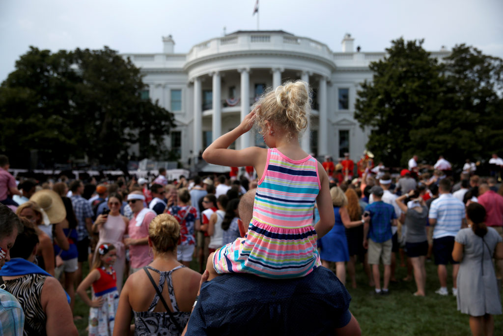 A girl wipes her face as she awaits the arrival of U.S. President Donald Trump and U.S. first lady Melania Trump at a picnic for military families celebrating Independence Day at the White House in Washington, July 4, 2018. Photo by Joshua Roberts/Reuters