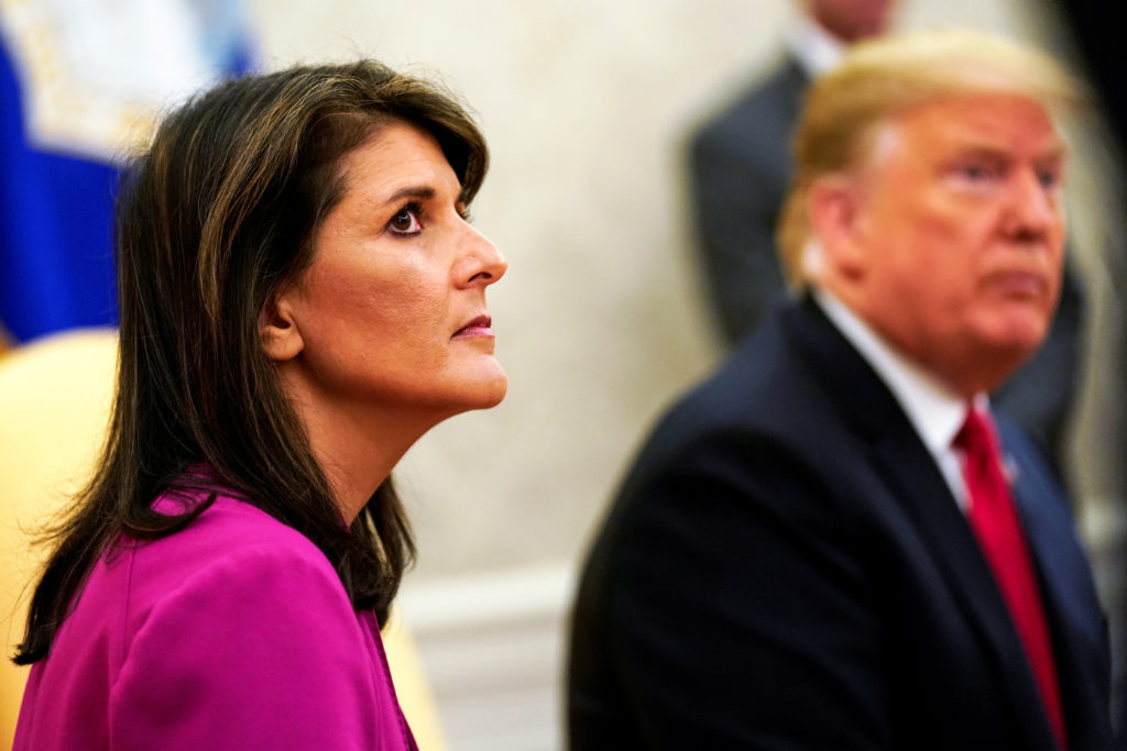 FILE PHOTO: U.S. President Donald Trump meets with U.N. Ambassador Nikki Haley in the Oval Office of the White House after it was announced the president had accepted the Haley's resignation in Washington, U.S., October 9, 2018. REUTERS/Jonathan Ernst
