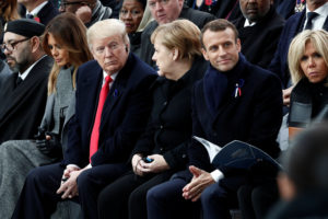 Brigitte Macron, French President Emmanuel Macron, German Chancellor Angela Merkel, U.S. President Donald Trump, first lady Melania Trump and Morocco's King Mohammed VI attend a commemoration ceremony for Armistice Day, 100 years after the end of the First World War at the Arc de Triomphe in Paris, France, November 11, 2018. Photo by Benoit Tessier/Pool via Reuters
