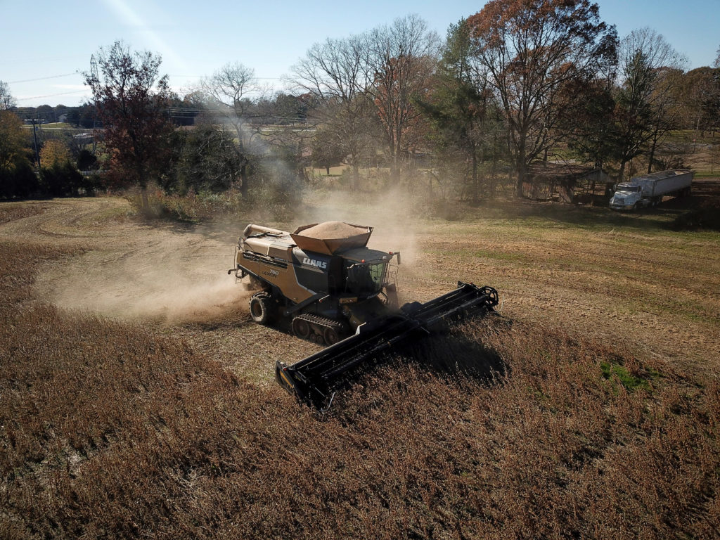 A farmer harvests a crop of soybeans at a farm in Hickory, North Ca…