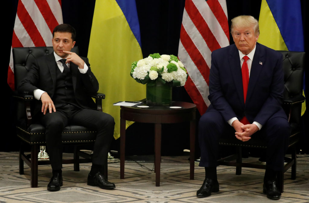 Ukraine's President Volodymyr Zelenskiy and U.S. President Donald Trump face reporters during a bilateral meeting on the s...