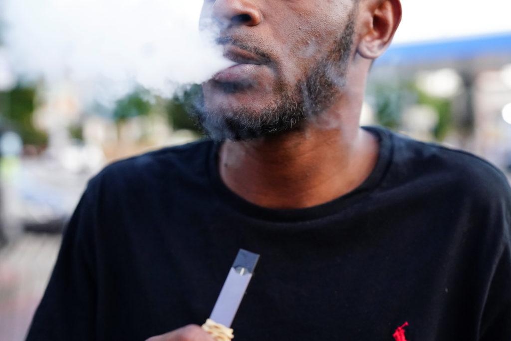 A man uses a Juul vaporizer in Atlanta, Georgia, U.S., September 26, 2019. Photo by Elijah Nouvelage/Reuters
