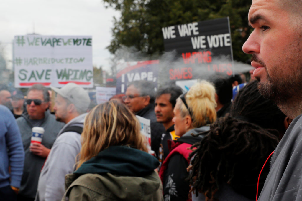 A demonstrator vapes during a protest at the Massachusetts State House against the state's four-month ban of all vaping product sales in Boston, Massachusetts, U.S., October 3, 2019. Photo by Brian Snyder/Reuters