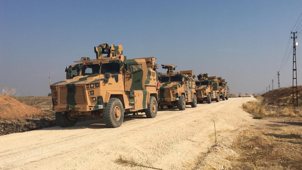 Turkish military vehicles are seen on the Turkish-Syrian border bef…