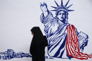 A woman walks in front of new murals of the former US embassy in Tehran, Iran November 2, 2019. Photo by Nazanin Tabatabaee/WANA (West Asia News Agency) via REUTERS