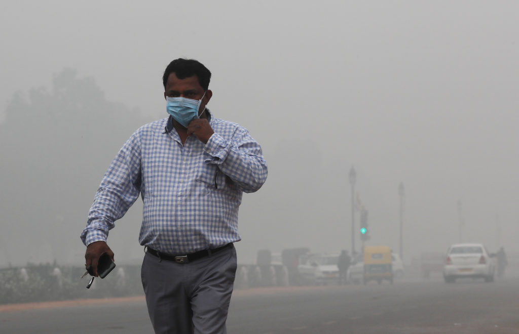 A man wearing a mask walks on a smoggy morning in New Delhi, November 3, 2019. Photo by Adnan Abidi/Reuters