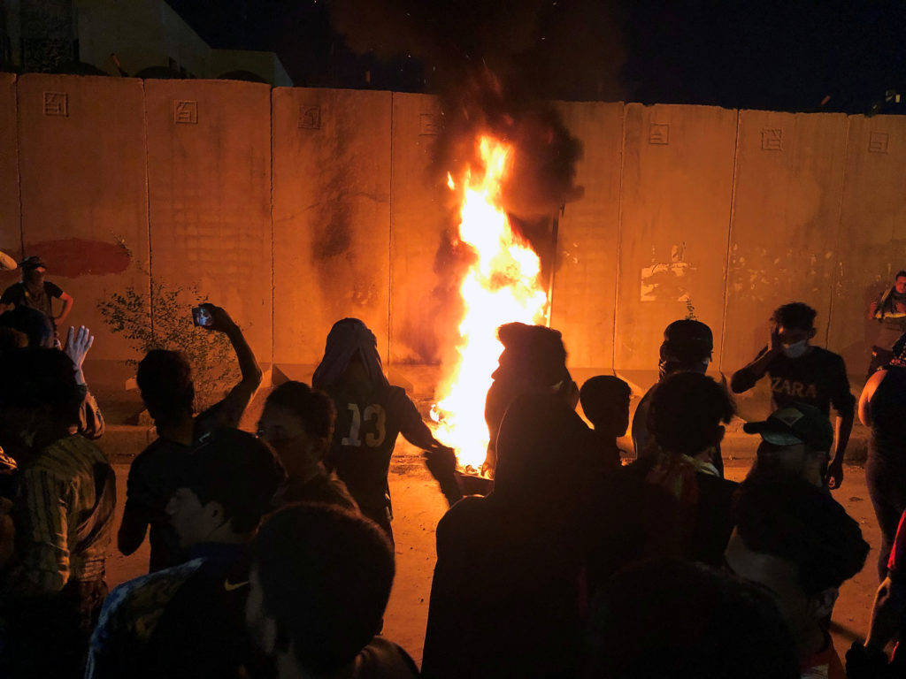 Demonstrators set fire in front of the Iranian consulate, as they gather during ongoing anti-government protests in Kerbala, Iraq November 3, 2019. Photo via Reuters