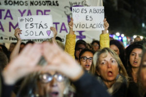 "Protesters hold placards as they attend a demonstration against a Spanish court which sentenced five of six men accused of gang-raping a 14-year-old girl to 10 to 12 years in prison for sexually abusing the minor, but acquitted them of rape, outside the Justice Ministry in Madrid, Spain, November 4, 2019. The placards read: ""You're not alone"" and ""It's not abuse, it's rape."" REUTERS/Sergio Perez"