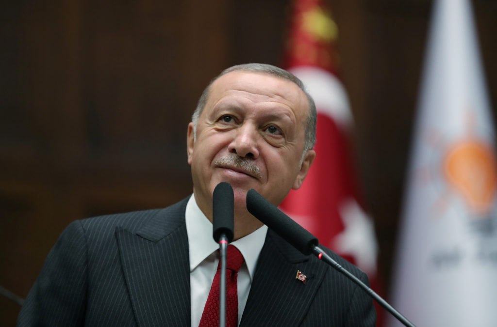 Turkish President Tayyip Erdogan addresses members of parliament from his ruling AK Party (AKP) during a meeting at the Tu...