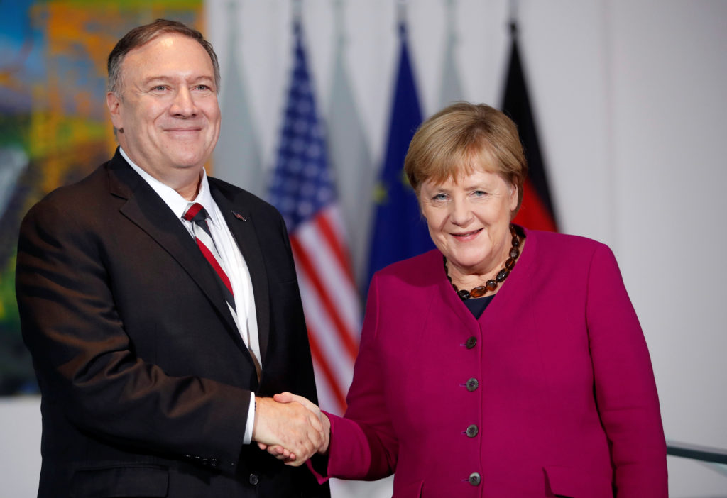 German Chancellor Angela Merkel shakes hands with U.S. Secretary of State Mike Pompeo during a news conference in Berlin, Germany November 8, 2019. Photo by Hannibal Hanschke/Pool via Reuters