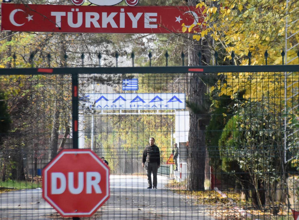 A man, a U.S. citizen of Arab descent and Islamic State suspect who was deported by Turkey, stands on the no-man's land between Turkey and Greece, as he is pictured from the Pazarkule border crossing near Edirne, Turkey, November 11, 2019. Picture taken November 11, 2019. Ali Can Zeray/Demiroren News Agency (DHA) via Reuters