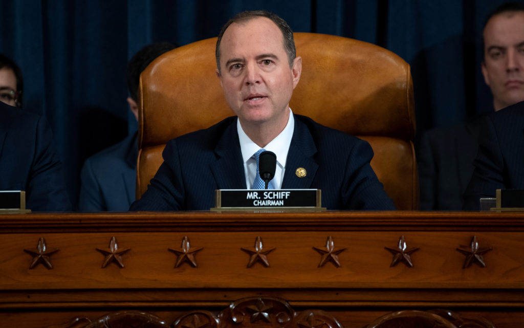 Chairman Adam Schiff (C), Democrat of California, gives an opening statement during the first public hearings held by the House Permanent Select Committee on Intelligence as part of the impeachment inquiry into U.S. President Donald Trump, with witnesses Ukrainian Ambassador William Taylor and Deputy Assistant Secretary George Kent testifying, on Capitol Hill in Washington, DC, U.S., November 13, 2019. Saul Loeb/Pool via REUTERS