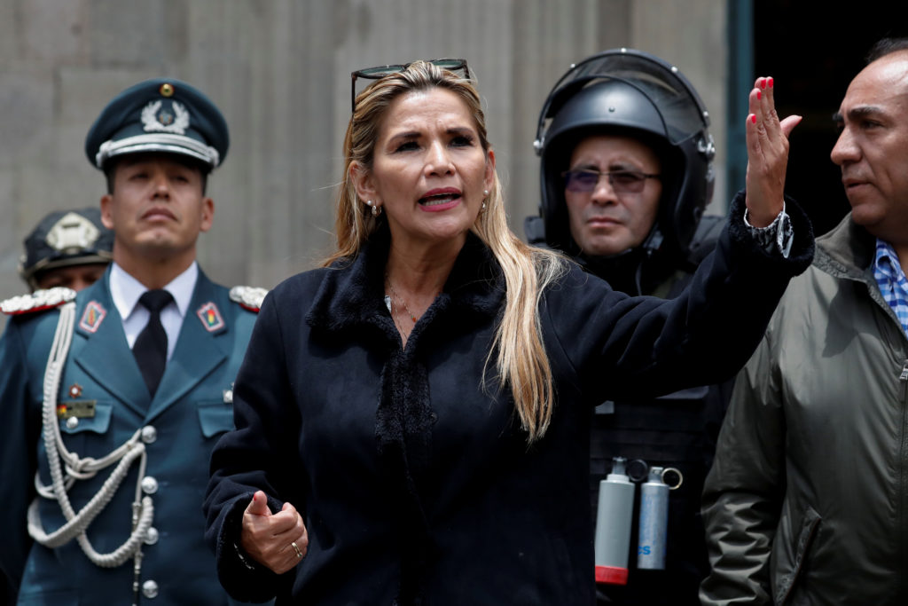 Bolivian Interim President Jeanine Anez takes part in a ceremony with the police in front of the Presidential Palace, in L...