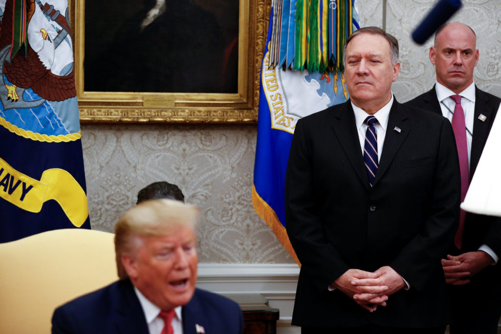 U.S. Secretary of State Mike Pompeo listens during a meeting between U.S. President Donald Trump and Turkey's President Tayyip Erdogan in the Oval Office of the White House in Washington, U.S., November 13, 2019. REUTERS/Tom Brenner