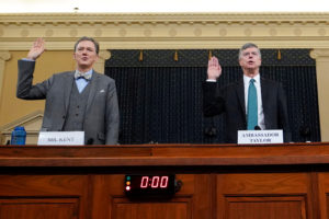 George Kent, deputy assistant secretary of state for European and Eurasian Affairs, and Ambassador Bill Taylor, charge d'affaires at the U.S. embassy in Ukraine;are sworn in at at a House Intelligence Committee hearing as part of the impeachment inquiry into U.S. President Donald Trump on Capitol Hill in Washington, U.S., November 13, 2019. Photo by Joshua Roberts/Pool/Reuters.