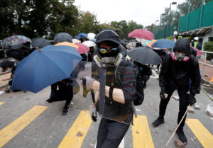 FILE PHOTO: Demonstrators stand with shields and umbrellas during an anti-government protest at the Chinese University of Hong Kong in Sha Tin, Hong Kong, China November 12, 2019. Photo by Shannon Stapleton/Reuters