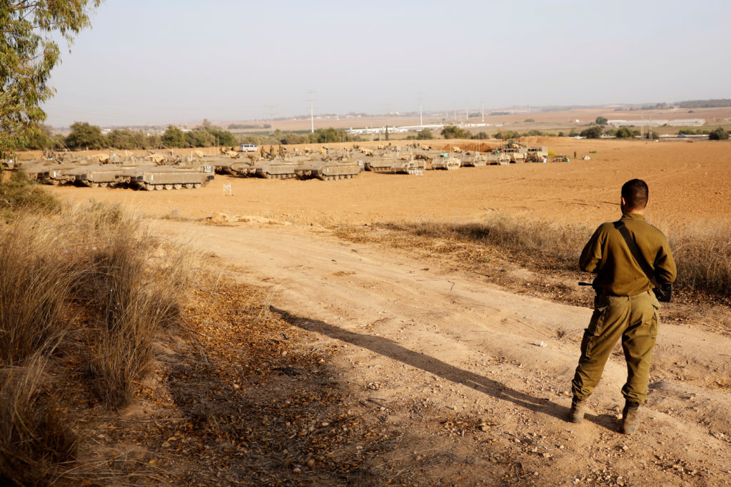 An Israeli soldier stands near a staging area near the border with Gaza, in southern Israel November 14, 2019. Photo by Ro...