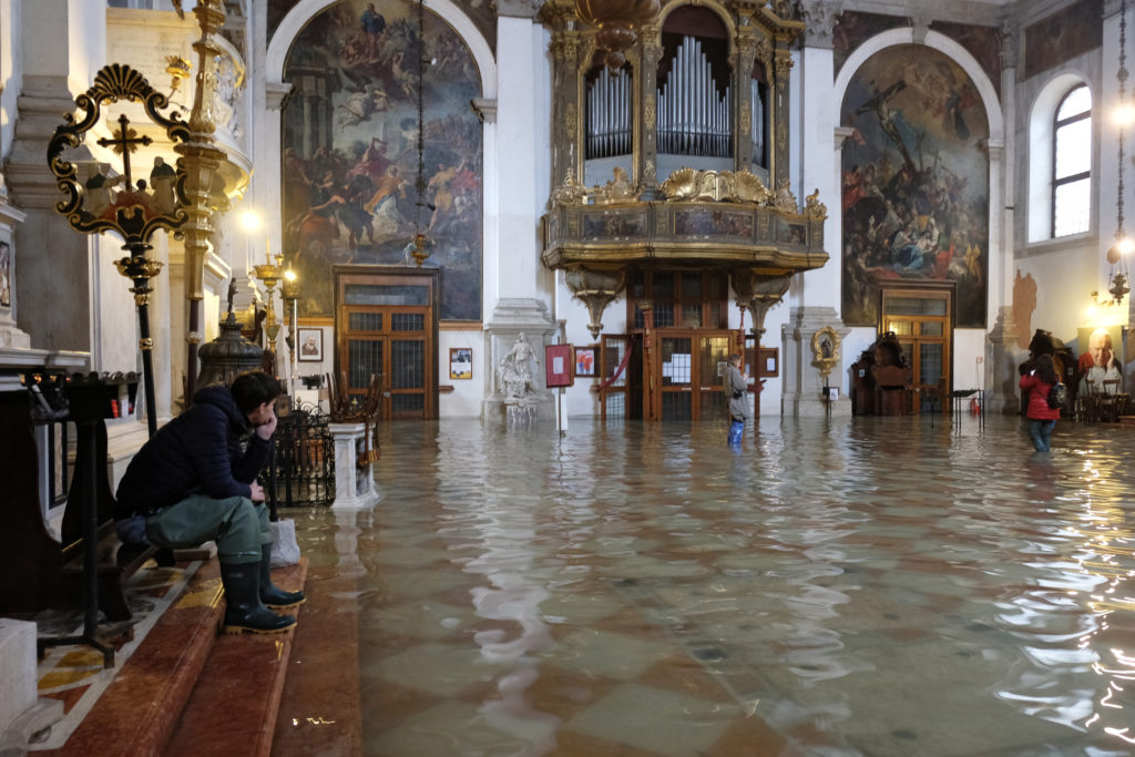 A flooded church is seen during a period of seasonal high water in Venice, Italy, November 17, 2019. Photo by Manuel Silvestri/Reuters