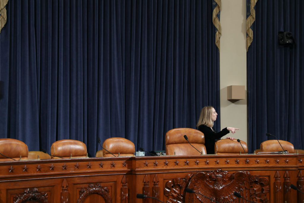 A congressional staff member prepares for Jennifer Williams, a special adviser to Vice President Mike Pence for European and Russian affairs, and Alexander Vindman, director for European Affairs at the National Security Council, to testify before a House Intelligence Committee hearing as part of the impeachment inquiry into U.S. President Donald Trump on Capitol Hill in Washington, U.S., November 19, 1019. Photo by Loren Elliott/Reuters