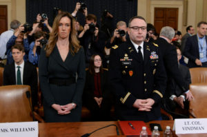 Jennifer Williams, a special adviser to Vice President Mike Pence for European and Russian affairs and Lt. Colonel Alexander Vindman, director for European Affairs at the National Security Council, take their seats to testify before a House Intelligence Committee hearing as part of the impeachment inquiry into U.S. President Donald Trump on Capitol Hill in Washington, U.S., November 19, 2019. REUTERS/Erin Scott