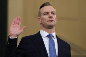 David Holmes, political counselor at the U.S Embassy in Kiev, takes the oath before he and Fiona Hill, former senior director for Europe and Russia on the National Security Council, testify to a House Intelligence Committee hearing as part of the impeachment inquiry into U.S. President Donald Trump on Capitol Hill in Washington, U.S., November 21, 2019. REUTERS/Loren Elliott