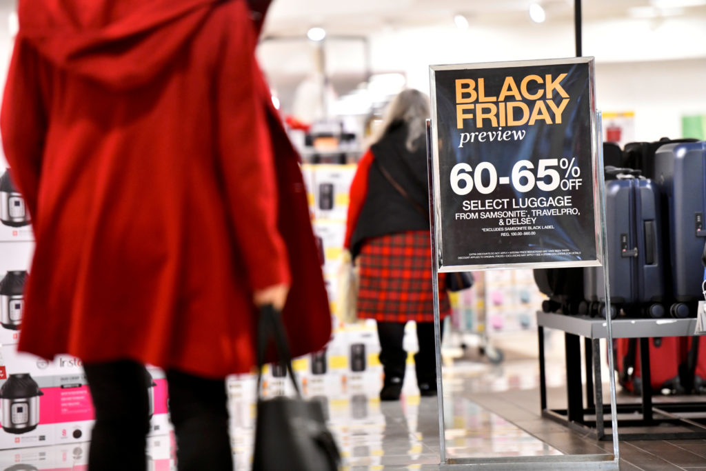 "Shoppers walk past a placard that states ""Black Friday preview"" at a Macy's store as pre-Thanksgiving and Christmas holiday shopping accelerates at the King of Prussia Mall in King of Prussia, Pennsylvania, on November 22, 2019. Photo by Mark Makela/Reuters"