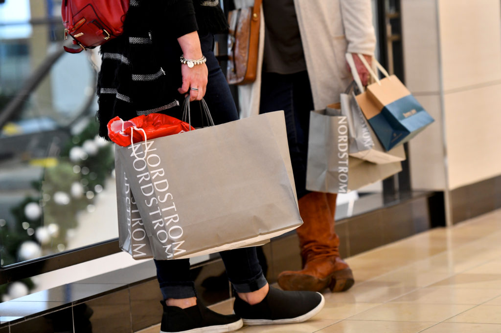 Shoppers clutch their Nordstrom bags as pre-Thanksgiving and Christmas holiday shopping accelerates at the King of Prussia Mall in King of Prussia, Pennsylvania, U.S. November 22, 2019. Photo by Mark Makela/Reuters
