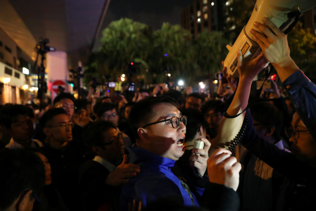 A pro-democratic district councilor-elect addresses pro-democracy protesters outside the Polytechnic University (PolyU) in Hong Kong, China, November 25, 2019. REUTERS/Leah Millis