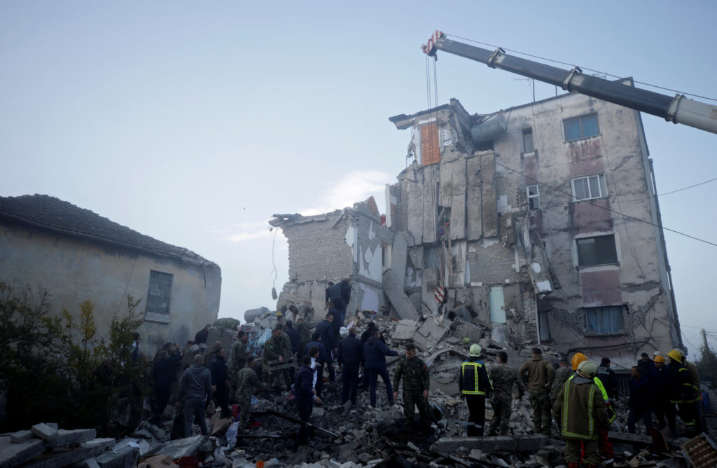 Emergency personnel work near a damaged building in Thumane, after an earthquake shook Albania, November 26, 2019. Photo by Florion Goga/Reuters
